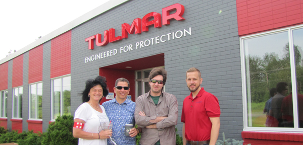 4 Tulmar Employees in front of HQ